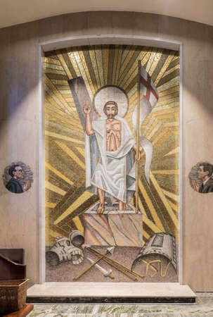 Galway, Ireland - August 5, 2017: Resurrection mosaic with side images of Patrick Pearse and John F. Kennedy in side chapel of Cathedral. Marble floor and wall. Jesus with flag stepping out of tomb. Weapons surrendered. Editorial