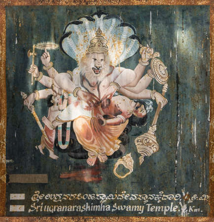 Mysore, India - October 27, 2013: Eight-armed Vishnu as Narashima on wall painting outside Chennakesava Temple, Somanathpur. Cruel scene of lion-man opening belly of demon-man. Editorial