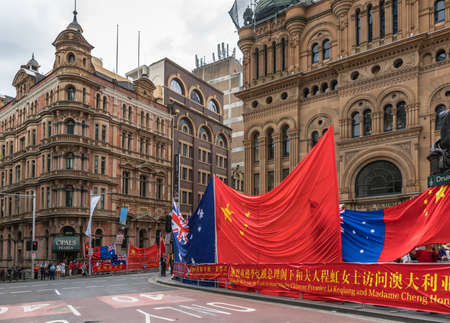 Sydney, Australia - March 25, 2017: Chinese living in Australia welcome Chinese Premier Li Keqiang in town with banners, giant flags and lots of noise at Druitt Street and corner of York Street.
