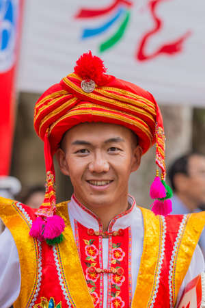 Sydney, Australia - March 25, 2017: Head shot of Chinese man living in Australia welcomes Chinese Premier Li Kequing with traditional dances, songs and music. Public square side of Town Hall.