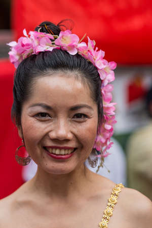 premier: Sydney, Australia - March 25, 2017: Head shot of Chinese woman living in Australia welcomes Chinese Premier Li Kequing with traditional dances, songs and music. Public square side of Town Hall.