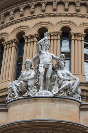 Sydney, Australia - March 25, 2017: Closeup of allegorical group frieze and statues on facade of historic Victoria shopping mall on York Street shows youth, science and art. Editorial