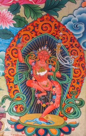 Coorg, India - October 29, 2013: Inside Padmasambhava Vihara of Namdroling Buddhist Monastery. Detail of wall painting. Vivid colors. Goddess Kali dancing on top of her final enemy.