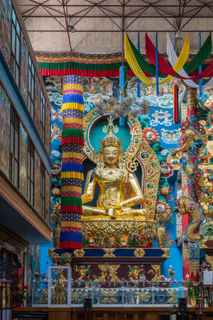 Coorg, India - October 29, 2013: Inside Padmasambhava Vihara of Namdroling Buddhist Monastery. The golden statue of guru Padmasambhava in front, surrounded by extemsive decor. Editorial