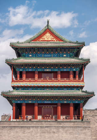 Beijing, China - April 27, 2010: Upper Structure in pagoda-style traditional architecture of Qianmen, Southern Gate, at edge of Tiananmen Square against blue sky. Reds, blues and gold. Editorial