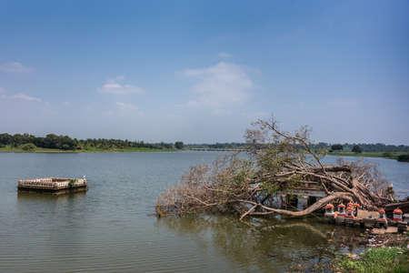 Arkeshwara temple partly submerged in Kaveri River. Banco de Imagens