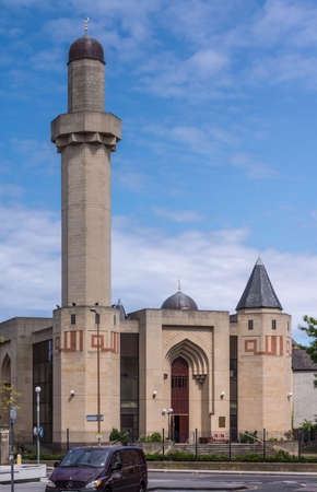 Edinburgh, Scotland, UK - June 13, 2012: The Central Mosque also know as King Fahd Mosque and Islamic Centre of Edinburgh against blue sky. Street scene.