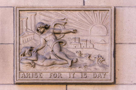 Edinburgh, Scotland, UK - June 13, 2012: Arise For It Is Day slogan as mural on beige-brown front facade of Central Library, features sunrise and angels.