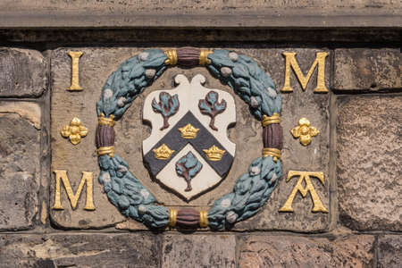 Edinburgh, Scotland, UK - June 13, 2012: Coat of arms on facade of John Knox House, a protestant reformer.
