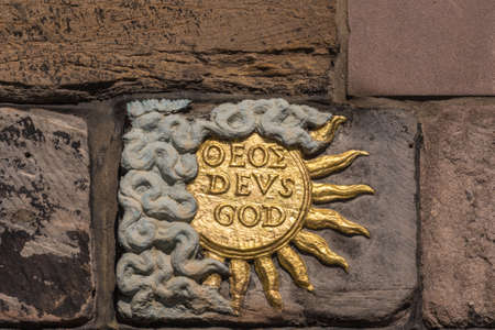 Edinburgh, Scotland, UK - June 13, 2012: Closeup of Golden Sun, named god and deus, on facade of John Knox House, a protestant reformer.