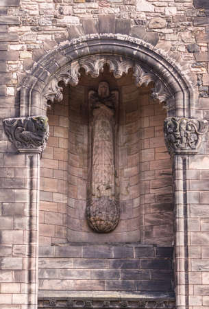 Edinburgh, Scotland, UK - June 14, 2012: Niche with statue of angel like female on Entrance tower to Brown stone Scottish National War Memorial at Castle. South Elevation Facade.