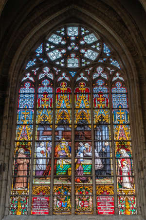 Brussels, Belgium - September 26, 2018: Stained Glass Window of Cathedral of Saint Michael and Saint Gudula.