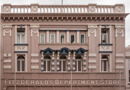 Hobart, Tasmania, Australia - December 14, 2009:  Historic Facade of Fitzgerald's Department Store shows arched windows, pillars and balcony on top.