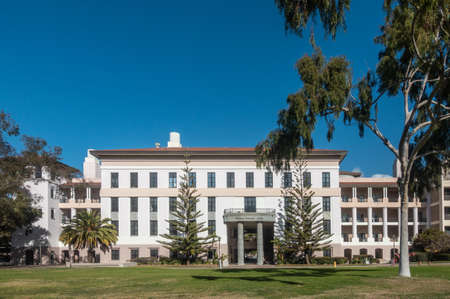Santa Barbara, California, USA - January 6, 2019: The white and beige modern Physical Sciences North building of UCSB, behind green lawn, trees, and under blue sky.