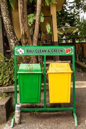 Bali, Indonesia - February 25, 2019: Ulun Danu Beratan Temple complex in Bedoegoel. Green and yellow trash cans. Reklamní fotografie