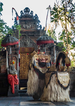 Banjar Gelulung, Bali, Indonesia - February 26, 2019: Mas Village. Play on stage setting. Four legged monster-king played by two actors in elaborate hairy costume and golden mask at temple building. Editorial