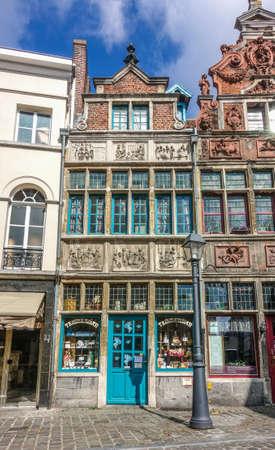 Gent, Flanders, Belgium -  June 21, 2019: Historic small shop on Kraanlei houses Confectioner Temmerman. authentic candy of a previous era. Six of Matthew Works of Mercy sculptures in facade.