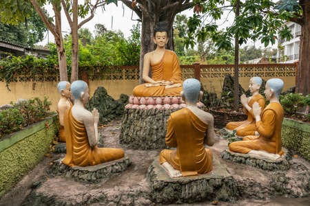 Bang Saen, Thailand - March 16, 2019: Wang Saensuk Buddhist Monastery. Group of colorful sculptures depicting Buddha giving his first sermon on noble truths to five disciples. Stock Photo