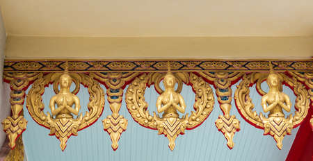 Ko Samui Island, Thailand - March 18, 2019: Wat Khunatam Buddhist Temple and monastery. Golden female chest and head ornaments as curtain over entrance to patio of temple building. Stockfoto - 133201833