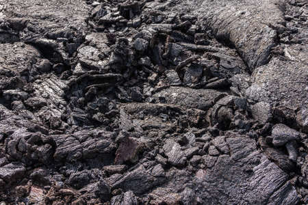 Leilani Estate, Hawaii, USA. - January 14, 2020: 2018 Kilauea volcano eruption hardened black lava field. Closeup of upper crust folds.