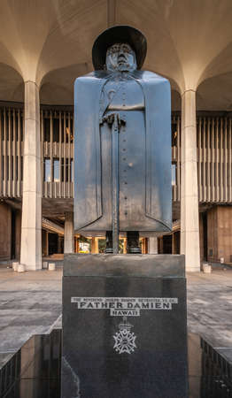 Honolulu Oahu, Hawaii, USA. - January 10, 2012: Closeup of bronze Statue of Catholic Saint Father Damien at front entrance to State Capitol.