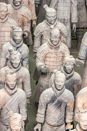Xian, China - May 1, 2010: Terracotta Army museum and hall. Group portrait of gray-beige ancient soldier sculptures at excavation. Editorial