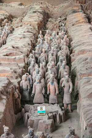 Xian, China - May 1, 2010: Terracotta Army museum and hall.  Trench packed with gray-beige soldier sculptures at excavation.