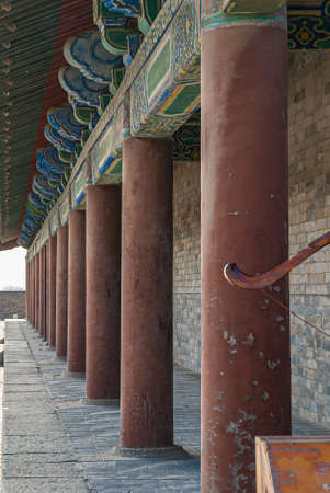 Xian, China - April 30, 2010: North Gate of Huancheng City Wall. Pillar wall and colorful decorated beams at palace above gate. Gray tiled surface. Editorial