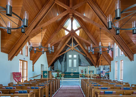 Los Olivos, California, USA - September 3, 2020: natural light shows interior of St. Marks in the Valley Church with light brown wooden ceiling and benches. Light azure walls. Organ in back. Editorial