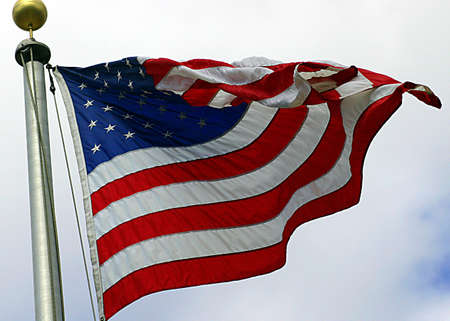 American Flag on Blue Sky Stock Photo