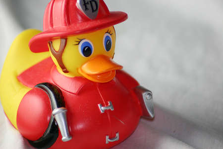 squeaky clean: Rubber Ducky Fireman Stock Photo