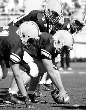 linemen: Offensive Line Football Stock Photo