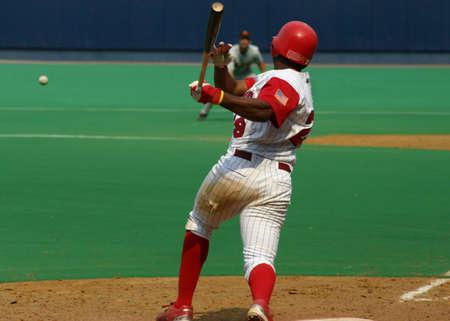 Baseball batter hitting the ball 写真素材
