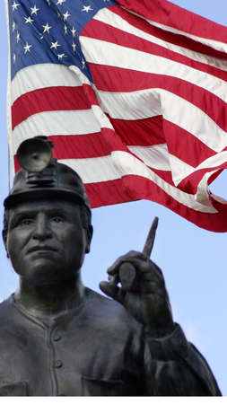 energy work: Miners Memorial with American Flag background Stock Photo