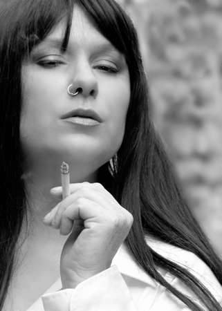 nosering: Lady with nose-ring smoking Stock Photo
