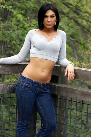 navel piercing: Beautiful brunette with nose piercing, leaning