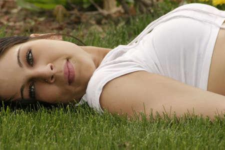 navel piercing: Beautiful lady lying down
