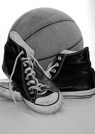 Old basketball and sneakers Stock Photo