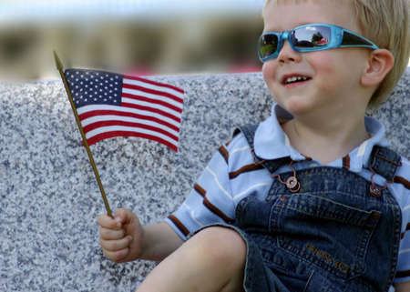 american children: Little boy with American Flag Stock Photo