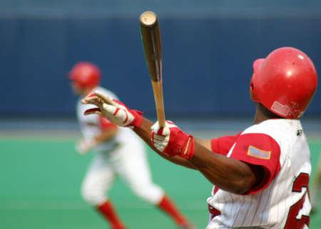 homerun: Baseball Batter swinging Stock Photo