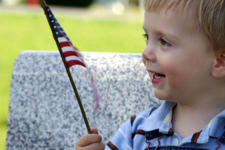 Little boy with an American Flag Stock Photo