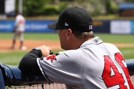 Indianapolis Indians pitching coach Tom Filer watches the game from the dugout against the Scranton Wilkes Barre Yankees at PNC Field on May 24, 2011 in Scranton, PA.