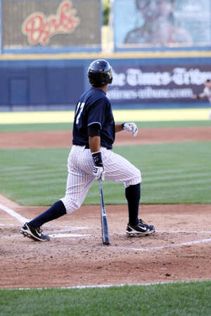 follow through: SCRANTON, PA - JULY 9: Scranton Wilkes Barre Yankees batter Terry Tiffee swings at pitch during a game against the Rochester Red Wings at PNC Field on July 9, 2011 in Scranton,