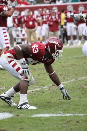 linemen: Temple University defensive end Adrian Robinson, Jr. (#43) is in a three-point stance against Buffalo on September 26, 2009 in Philadelphia, PA.  Editorial