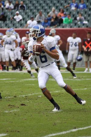 linemen: PHILADELPHIA, PA. - SEPTEMBER 26 : Buffalo Quarterback Zach Maynard throws a pass against Temple on September 26, 2009 in Philadelphia, PA. Editorial