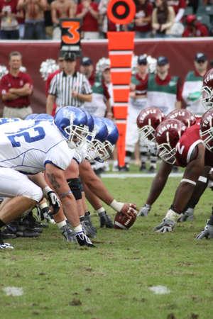quarterback: PHILADELPHIA, PA. - SEPTEMBER 26 : Buffalo Offensive Line prepares to hike the football against Temple on September 26, 2009 in Philadelphia, PA.