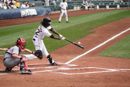 PITTSBURGH - SEPTEMBER 24 : Andrew McCutchen of the Pittsburgh Pirates swings against Cincinnati Reds on September 24, 2009 in Pittsburgh, Pa. Editorial
