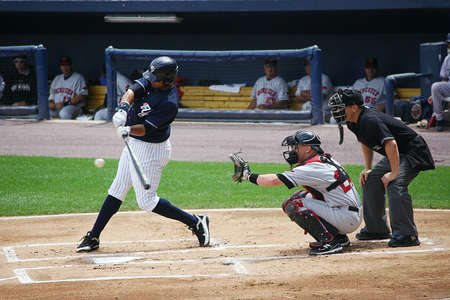 follow through: SCRANTON, PA - AUGUST 24  Scranton Wilkes Barre Yankees batter Chris Dickerson hits the ball in a game against the Rochester Red Wings at PNC Field on August 24, 2011 in Scranton, PA  Editorial