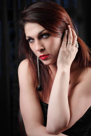 Beautiful elegant woman, hand on her face photo