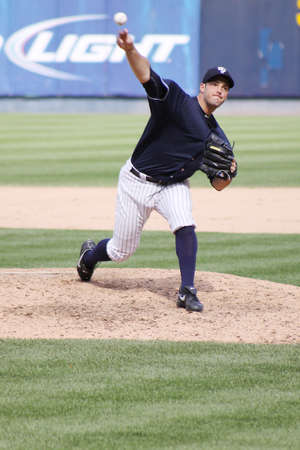SCRANTON, PA - AUGUST 24: Scranton Wilkes Barre Yankees pitcher George Kontos fires a pitch in a game against the Rochester Red Wings at PNC Field on August 24, 2011 in Scranton, PA.  Stock Photo - 13512495